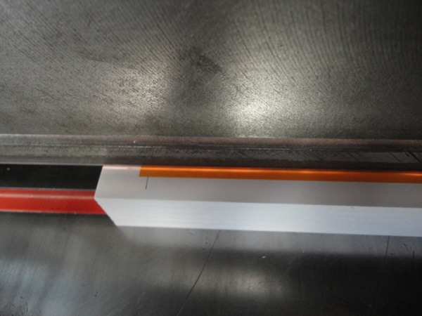 Stack of paper showing bleed being cut